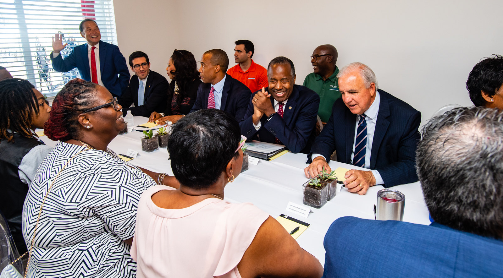 Secretary Carson, Executive Director Turner, and Miami-Dade County Mayor Carlos Gimenez meet with Liberty Square residents during an Opportunity Zones event in Miami, FL